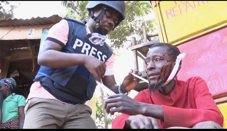 BBC journalist Allan Atulinda attempts to give first aid to 'Sweet Pepsi'