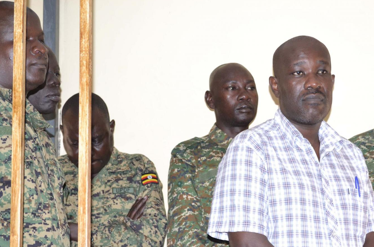 Kipoi (R) in the army court dock in Uganda earlier