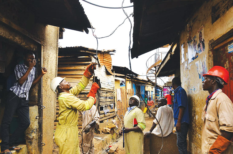 Umeme officials inspecting illegal connections