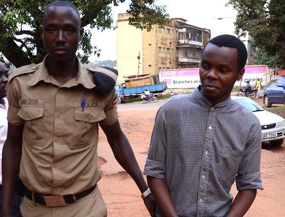 Justine Malimali Ndihoma Sisco Mashal (R) after arrest