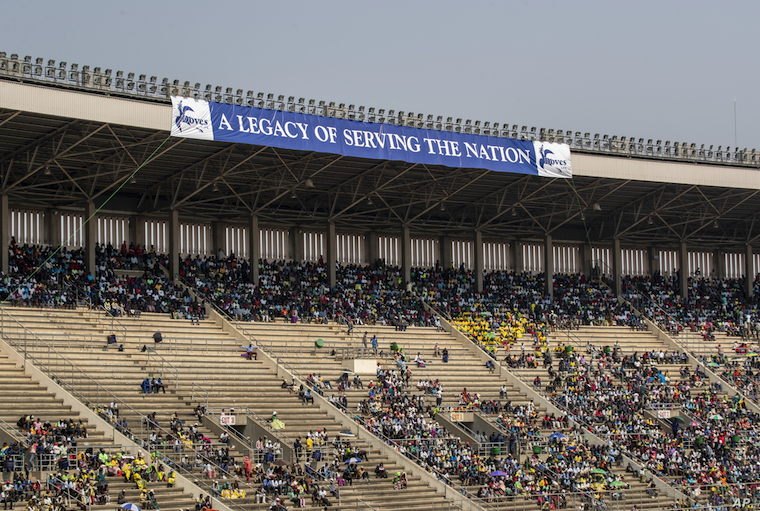 Members of the public sit in the stands during the state funeral for former president Robert Mugabe, at the National Sports Stadium, in the capital Harare, Zimbabwe