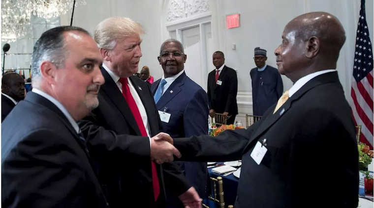 Museveni shakes hands with US President Donald Trump