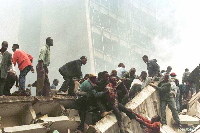 FILE - An injured man is removed from the wreckage after an explosion near the U.S. Embassy in Nairobi on Aug. 7, 1998.