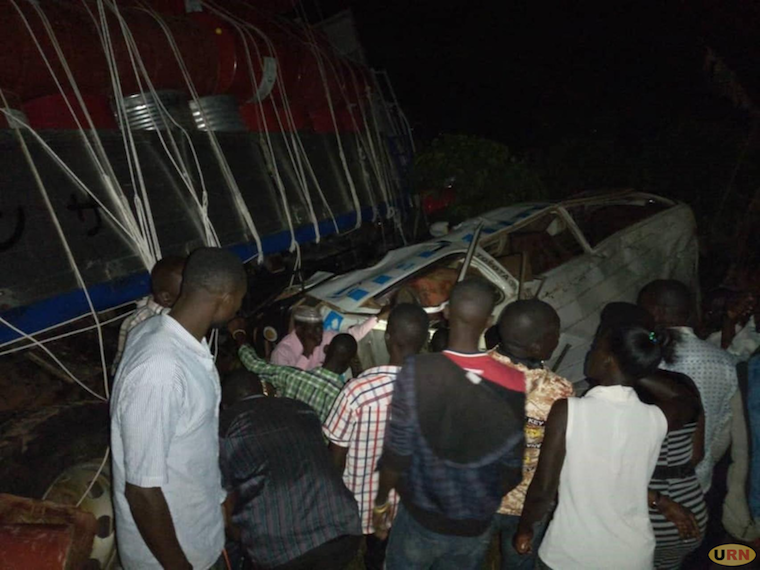 Residents staring at taxi which collided with Fuso Truck a