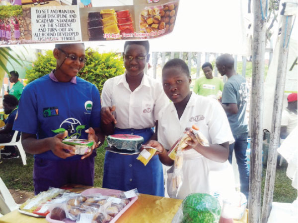 Students of Tororo Girls School exhibit the agribusiness skilling products at a trade fair