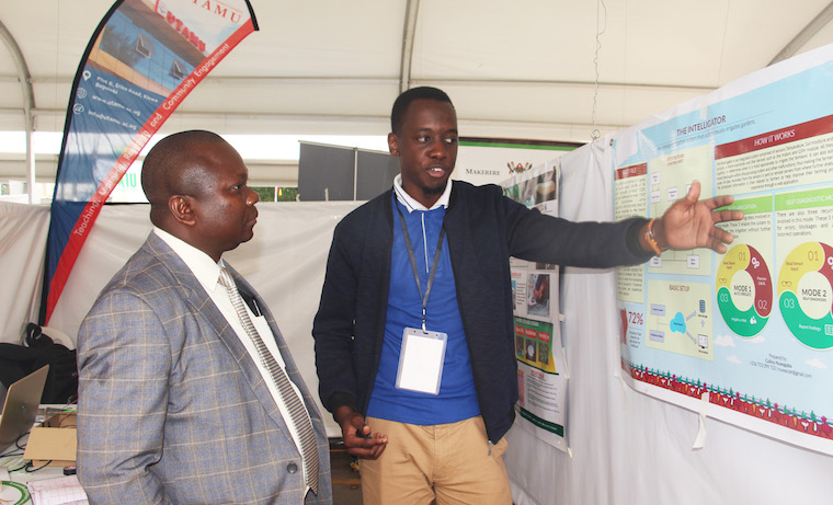 Collins Niwagaba explains the Hybrid Irrigation System at 2018 Parliamentary exhibition in Kampala