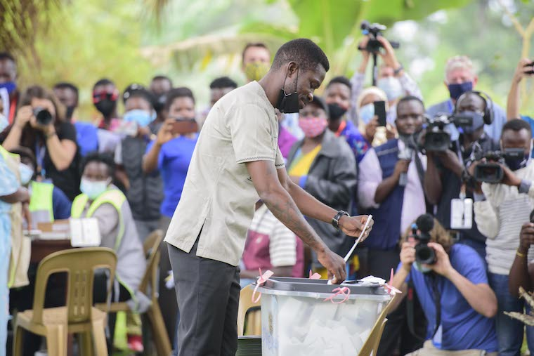Bobi Wine casting his ballot last week. He has been under house arrest for a week now
