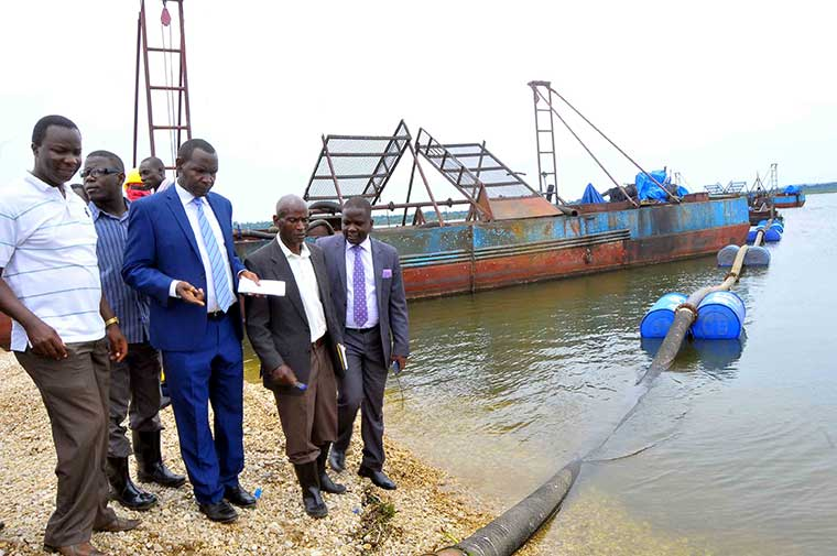MPs on the committee of Natural Resources and officials from NEMA examine the effects of sand mining on Lake Victoria