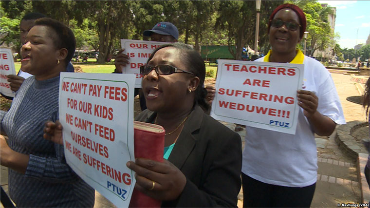 Teachers demanding to be paid in U.S. dollars take to the streets in Harare, Zimbabwe last year
