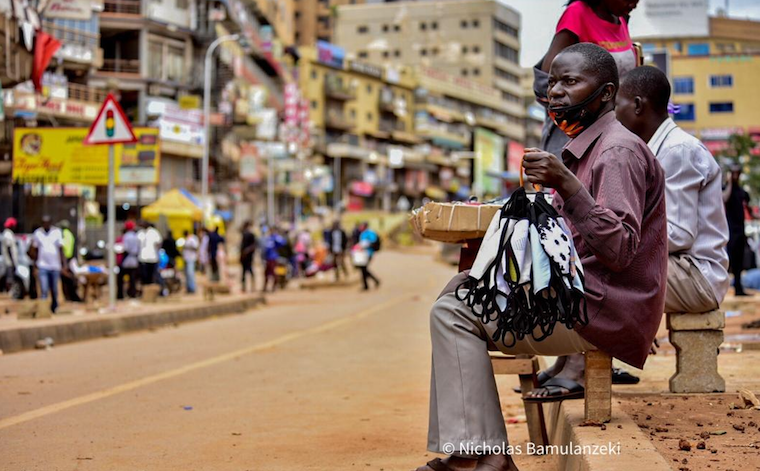Man selling home made face masks in Kampala