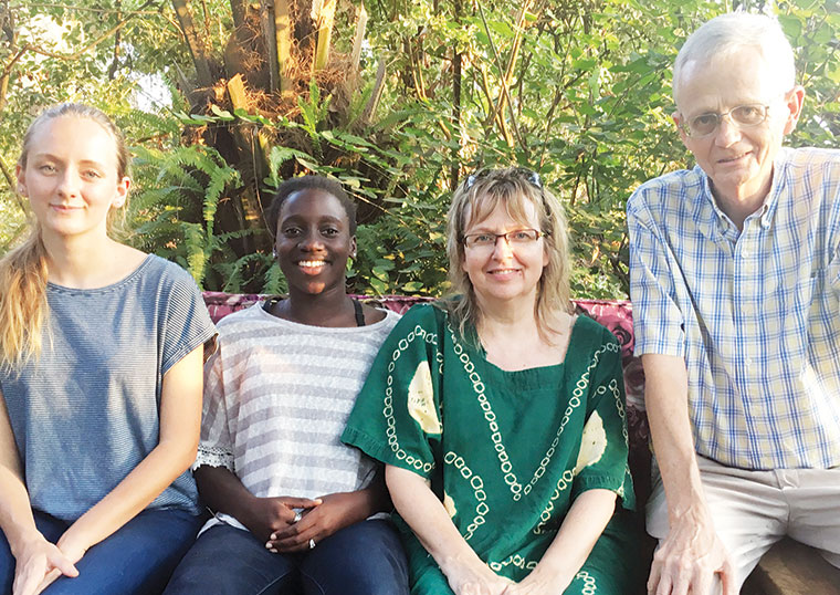 Dr Chapman (R) with his family (L-R) daughters Briana Nakimuli, Sophia Kirabo Nanteza and wife Lynn Jenny