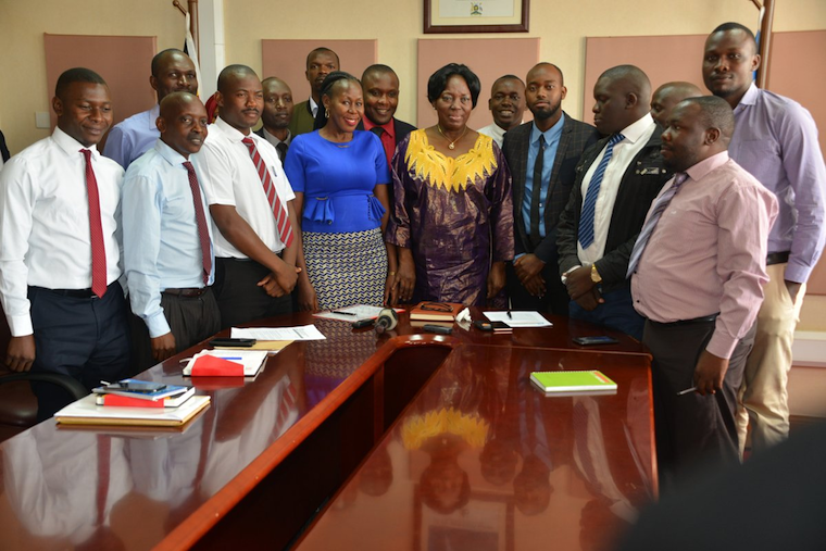 The journalists in a group photo with speaker Rebecca Kadaga