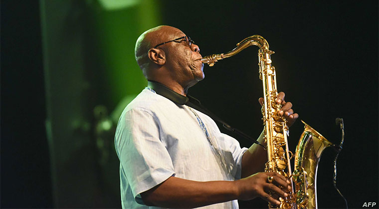 Manu Dibango, saxophonist and Franco-Cameroonian singer of world jazz, performs during his concert at the Ivory Hotel Abidjan