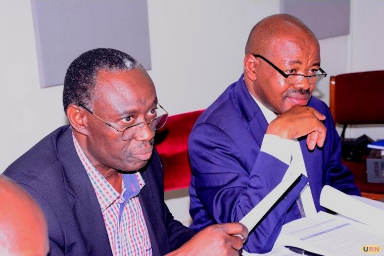 Budget Committee chairperson Amos Lugoloobi (R) with the vice chairman Patrick Isiagi.