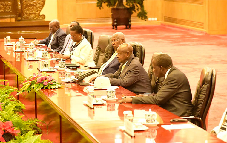 President Museveni with a delegation of Ugandan ministers and officials in China