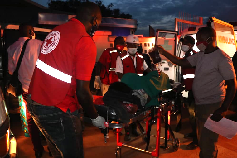 One of the injured victims being rescued by Uganda Red Cross Society personnel