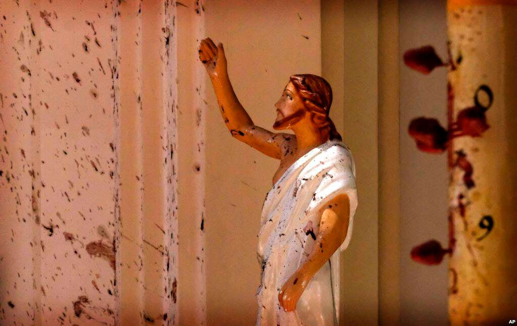 PICTURE THE DAY: Blood stains are seen on the wall and on a Jesus Christ statue at the St. Sebastian's Church after blast in Negombo, north of Colombo, Sri Lanka