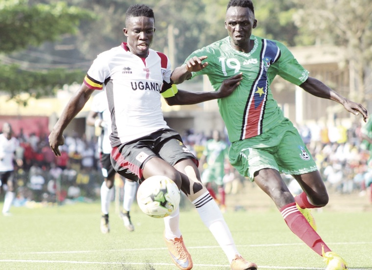 Julius Poloto (L) in action against South Sudan in an Under-20 Africa qualifier in 2019