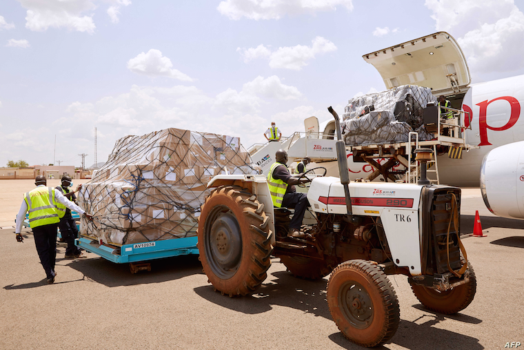 FILE - Airport staff unload cargo sent by Chinese billionaire Jack Ma and his Alibaba Group after it arrives at Juba International Airport, in Juba, South Sudan, March 24, 2020